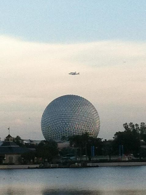 Space Shuttle Endeavor flew by EPCOT Center and Spaceship Earth this morning on her final journey out west, earlier today.  (WOW.) Photo by Twitter user @Crushinat0r