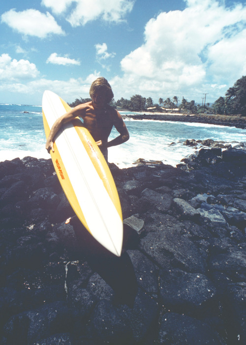 Tom getting ready for a surf session in Kauai on a custom made SIMS Surfboard. Late 1970's.#foreveralegend