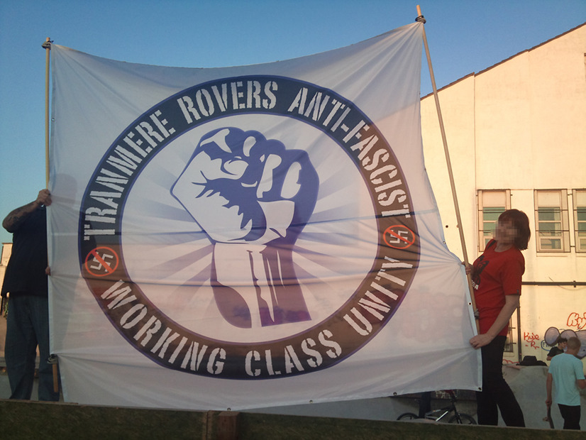 "Tranmere Rovers Anti-fascists ""But perhaps the most interesting of recent developments on the terraces of Prenton Park has been the formation of Tranmere Rovers Anti-fascists (TRAF). With their mighty 12ft high banner declaring working class unity, TRAF have been promoting anti-fascism in the local area as a response to the increased presence of the EDL at home games. They have already had a mass leafleting campaign outside the ground and been involved in joint actions with other anti-fascist groups, including joining anarchists in Liverpool to counter the BNP's protest against Question Time being recorded in the city.""  - Originally posted on Indymedia, November 2011"