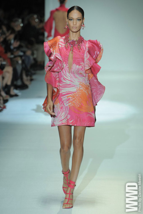 Gucci RTW Spring 2013 The mood for Frida Giannini's spring collection was at once spare and flamboyant, retro but not impossibly so.  For More See all of WWD.com's RTW Spring 2013 Runway Coverage