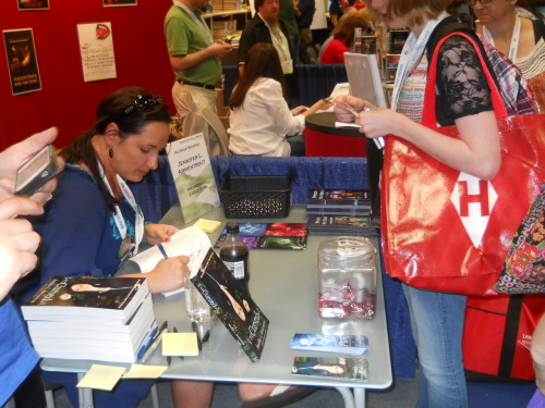 Jennifer L. Armentrout signing books at BEA 2012 in NYC.