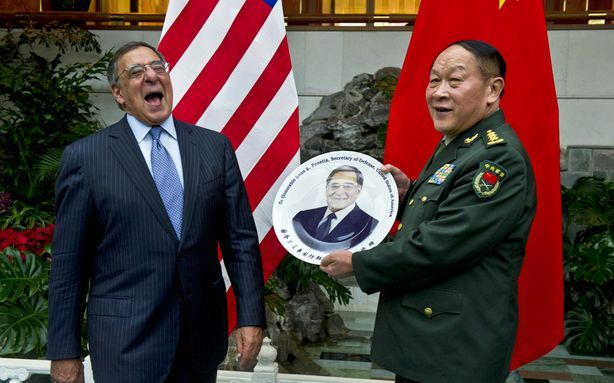 Leon Panetta Is Very Happy About This Commemorative Plate [Image: Defense Department]