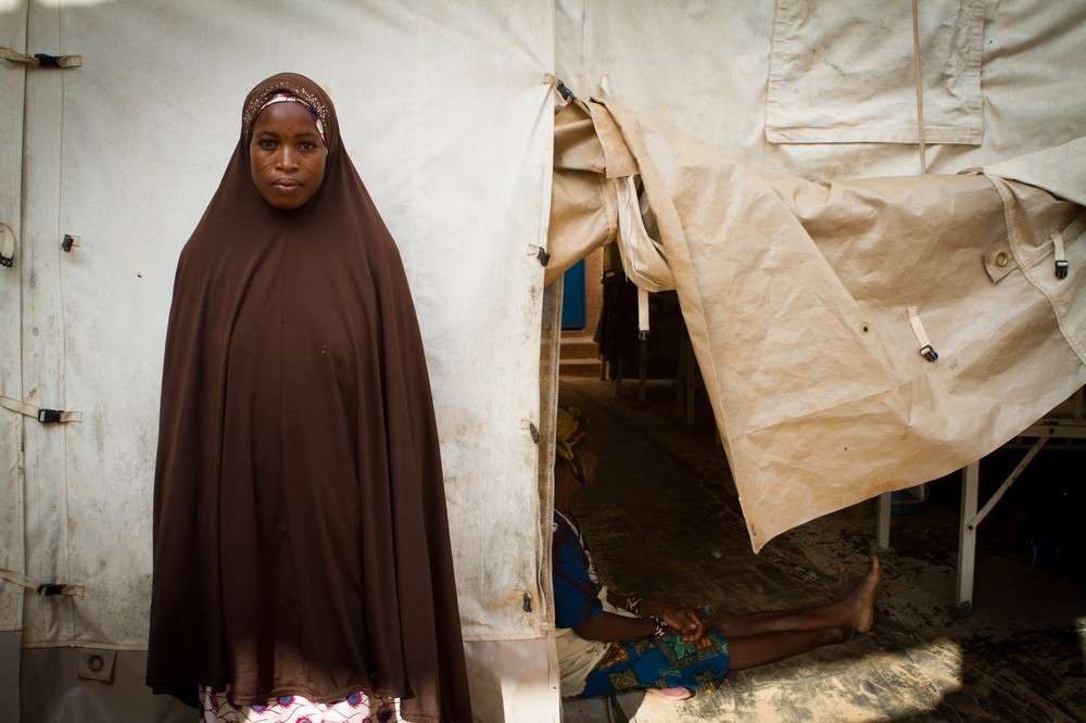 doctorswithoutborders:  Photo: A young mother stands outside of a MSF tent in Niger, where her baby has been admitted for severe malnutrition. © Tanya Bindra/Al Jazeera Hunger Stalks Niger About six million people are at risk of going hungry in Niger due to population growth, rising prices for staple foods, and lack of basic healthcare. Individual family efforts to make ends meet are faltering, as the queue of undernourished mothers and children continue to grow at relief camps. More photos of the hunger battle here.