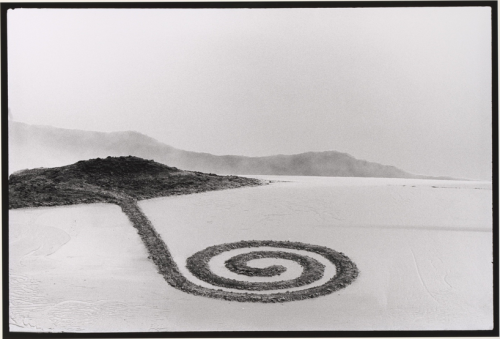 "cavetocanvas:  Vik Muniz, Brooklyn (Spiral Jetty after Smithson), 1997 From the Metropolitan Museum of Art:  Virtuoso of the commonplace, Muniz creates witty conceptual tableaux out of humble matter-fake etchings out of miles of thread, cloudscapes from cotton or marble floor patterning-that comment wryly on history and memory, perception and illusion. Continuing his affectionate assault on the giants of twentieth century art, Muniz created a Lilliputian version of Spiral Jetty-the late Robert Smithson's earthwork in the Great Salt Lake, Utah-out of dirt in his Brooklyn studio. While Muniz assumes the role of basement tinkerer to Smithson's Faustian persona, both created earthworks with dizzying shifts in scale and a marked temporal aspect: Spiral Jetty emerges and disappears with the tides while its Brooklyn miniature was erased with a tilt of the table. Most importantly, Muniz highlights the crucial role that photography played in the Smithson ""original,"" a site-specific work whose remoteness is counterbalanced by the camera's capacity for infinite reproduction and dissemination."