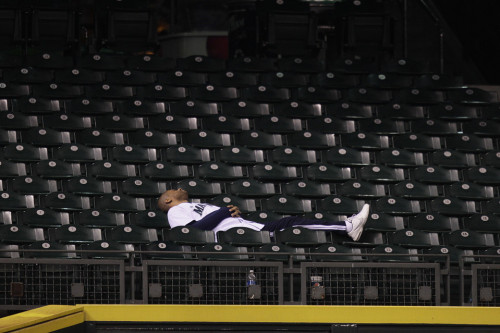 inothernews:  WIN SOME SNOOZE SOME  A fan rested between innings of an 18-inning baseball game between the Baltimore Orioles and the Seattle Mariners in the early hours of Wednesday in Seattle. The Orioles beat the Mariners, 4-2. (Photo: Ted S. Warren / AP via The Wall Street Journal)
