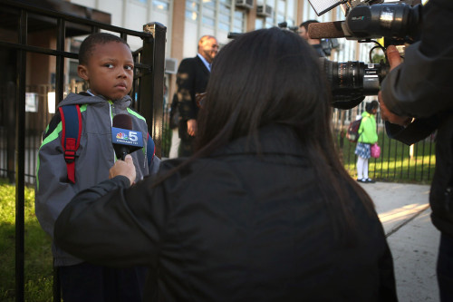 inothernews:  FROWNBITE   Student Camren Jenkins was interviewed by a local TV news reporter as he waited for school to start at Frazier International Magnet School Wednesday in Chicago. Teachers and students were returning to class after teachers' union officials voted to end a seven-day strike. (Photo: Scott Olson / Getty Images via The Wall Street Journal) I love everything about this photo.  Everything.  I'd love to hear what he had to say …