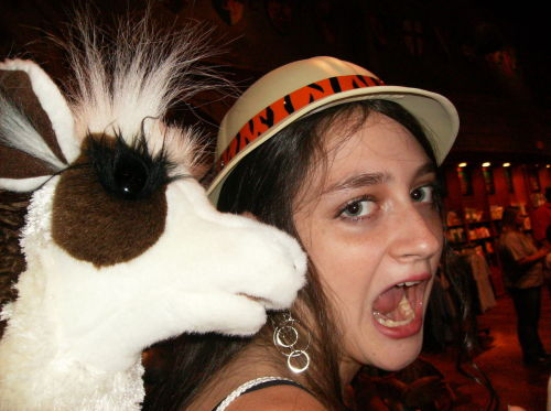 My Best friend being eaten by a stuffed Llama. No Big Deal. <3