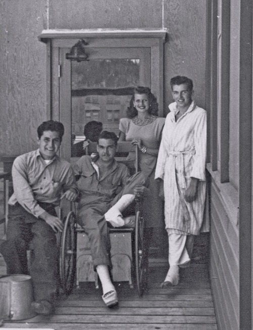 Rita Hayworth visiting a hospital ward during WW II