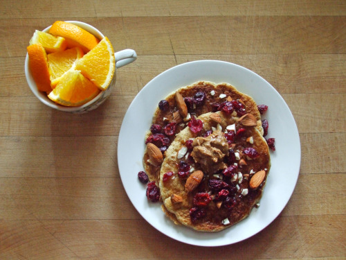 garden-of-vegan:  whole wheat pancakes with almonds, almond butter, cranberries, and maple syrup, and an orange
