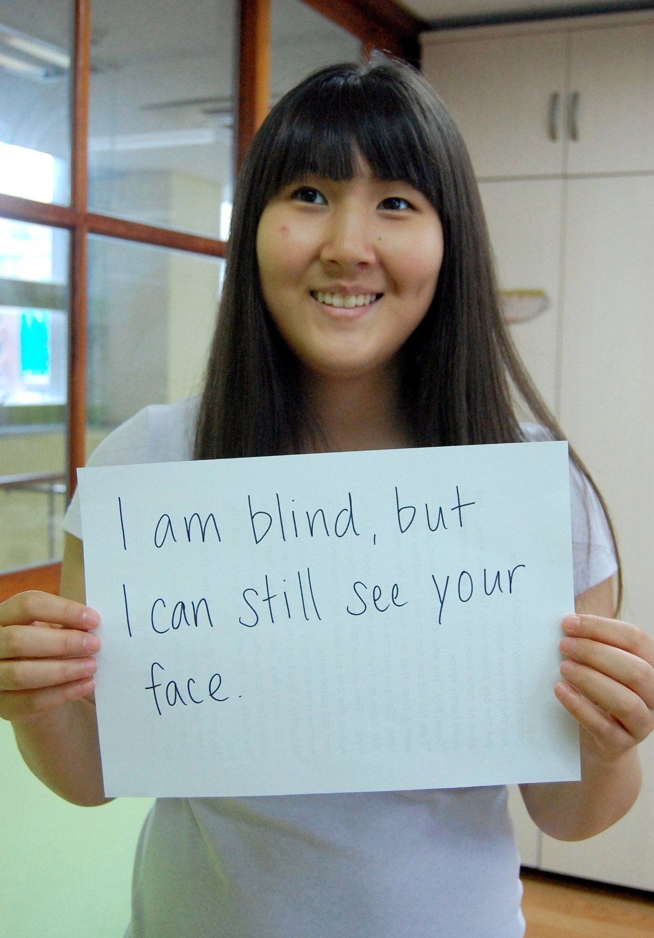 I am blind, but I can still see your face.