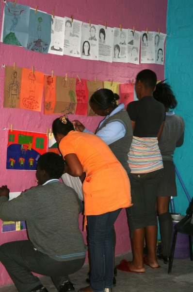 Picture of the week: Rehauhetswe students hanging their work.  This is VERY important as it gives them a sense of completion and accomplishment at the end of each art project!