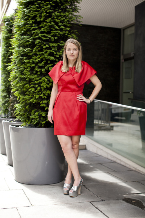 Go red hot in this organza dress with an on-trend capelet!