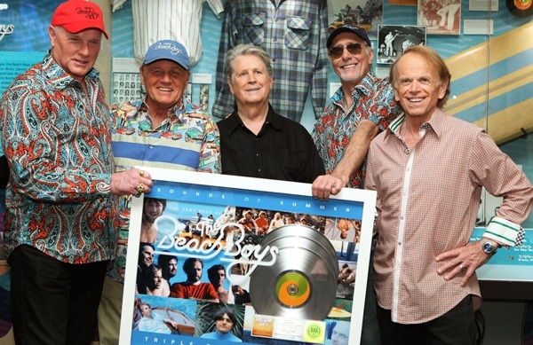 Brian Wilson Holds Out Hope for New Beach Boys Music 'I'm sure by early next year we'll be ready to rock' If the Beach Boys' 50th anniversary reunion tour is coming to an end, the legendary group is going out with a bang. On Tuesday evening, Brian Wilson, Mike Love, Al Jardine, Bruce Johnston and David Marks gathered at Los Angeles' Grammy Museum for a night of festivities, including an acoustic performance and the launch of a new exhibit chronicling the group's history. Among the items featured: a high school philosophy paper written by Brian Wilson, signed copies of Pet Sounds and Sgt. Pepper's Lonely Hearts Club Band (by Wilson and Paul McCartney, respectively), old tour posters and some of the group's most iconic surfer shirts. The the complete Rolling Stone article