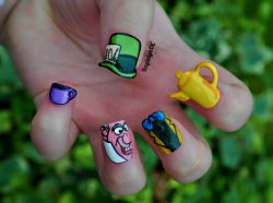 "kayleighoconnor:  Mad Hatter nails :)I started these months ago (by making the hat) and then got bored with them. A few weeks ago I made the teapot, then the cup a few days later. Only got round to finally finishing them last night. Phew!I'm glad that I did get them done in the end though :)""Why is a raven like a writing desk?.."""