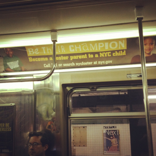 The posters are baaa-aaaack. G train. Just curious, how much do you think the ads cost to run? And how do they choose which train to post on?