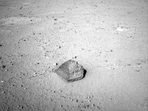 "Mars' Curiosity to Examine Odd Rock en Route to Mount Sharp — Curiosity is about 8 feet (2.5 meters) from an unusual rock. It lies about halfway from the rover's landing site, Bradbury Landing, to a location called Glenelg. In coming days, the team plans to touch the rock with a spectrometer to determine its elemental composition and use an arm-mounted camera to take close-up photographs. ""As we're getting closer to the light-toned area, we see thin, dark bands of unknown origin,"" said Mars Science Laboratory Project Scientist John Grotzinger of the California Institute of Technology, Pasadena. ""The smaller-scale diversity is becoming more evident as we get closer, providing more potential targets for investigation."" Both the arm-mounted Alpha Particle X-Ray Spectrometerand the mast-mounted, laser-zapping Chemistry and Camera Instrument will be used for identifying elements in the rock. This will allow cross-checking of the two instruments. Curiosity now has driven six days in a row. Daily distances range from 72 feet to 121 feet (22 meters to 37 meters). The rock has been named ""Jake Matijevic."" Jacob Matijevic (mah-TEE-uh-vik) was the surface operations systems chief engineer for Mars Science Laboratory and the project's Curiosity rover. He passed away Aug. 20, at age 64. Matijevic also was a leading engineer for all of the previous NASA Mars rovers: Sojourner, Spirit and Opportunity. (via dailygalaxy)"