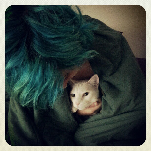 My cat Coco and I hate the cold weather, so we stay snuggled together in the morning. (Taken with Instagram)