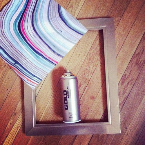 Newest DIY project! I spray painted cheap black frames a shiny gold, and used marbled paper with metallic striations as wall art! #diy  (Taken with Instagram)