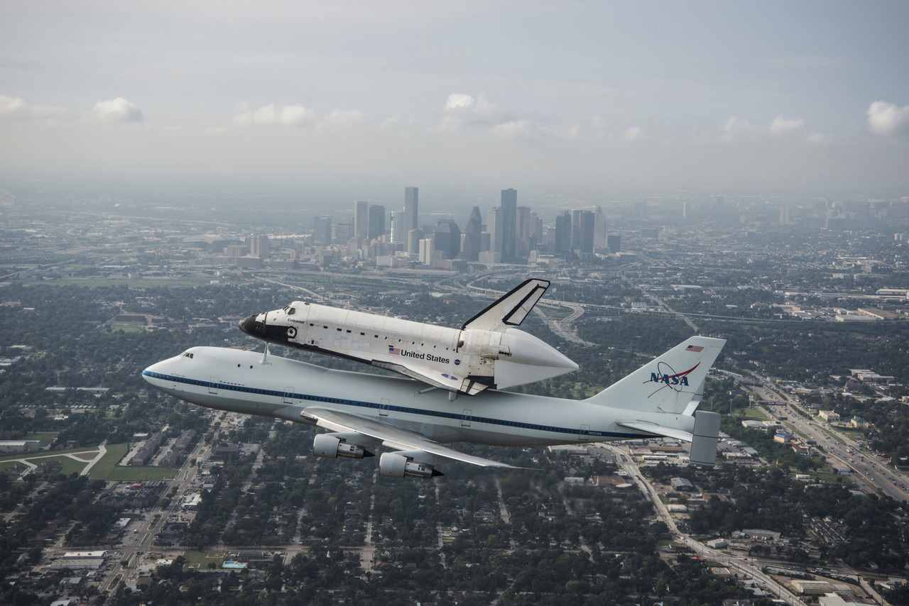 The space shuttle Endeavour, atop NASA's Shuttle Carrier Aircraft, flies over Houston, Texas in this September 19, 2012 NASA handout photo. The SCA, a modified 747 jetliner is flying Endeavour to Los Angeles where it will be placed on public display at the California Science Center. This is the final ferry flight scheduled in the Space Shuttle Program era. [REUTERS/Sheir Locke/NASA/Handout] PHOTOS: The best Reuters photography from the past 24 hours