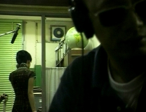 "Wong Kar-wai: ""It was an unfulfilled wish. I wanted to put them together several years ago, in Days of Being Wild, but never got to. At first, I had wanted all the characters in this film to be played by Maggie and Tony, everyone down to the extras, but the concept was too ambitious… Maybe next time."" Tony Leung: ""I grew up with many neighbors, very much like you see in the film. The economy wasn't so good and people worked hard; they couldn't afford to live alone. We rented out rooms and I remember a lot of gossiping, a lot of quarreling. It's different in Hong Kong these days—you don't even know who lives next door."" Maggie Cheung: ""My strongest memories of the period are of my mother, which actually helped me with this film—the cheongsams, the shoes, the handbags, her visits to the hairdressers, the way she stood and walked and talked."" Wong Kar-wai: ""It's a very challenging film for actors. These are the most boring parts they could get—normal people, thirtysomething, married, nothing colorful or heroic. They both went through a period of trying to do something to prove they were acting, but I kept telling them not to, because the whole point was to borrow something of theirs. I didn't invent a character and look for an actor to play it. It wasn't a case of casting the right person for the role. We already had the actors; everything was custom-made for them."" Tony Leung: ""I knew what to expect and what was needed—just don't set any limits, no preparation required. I do research for other directors but not Kar-wai. I don't even have to ask him very much; I usually have a good idea of what he wants."" Maggie Cheung: ""Kar-wai just kept wanting to know what we could give him. And I was holding back, because I was like, 'If you're not going to give me anything to do, I'm not going to do anything. Just watch me.' Until finally, he wore me out so much that I didn't care anymore, I went out and just did it. And that's when it all came. It took me six months to actually open up to him. If I hadn't, the shoot would have lasted forever. Him waiting for me, me waiting for him. We'd still be shooting now."""