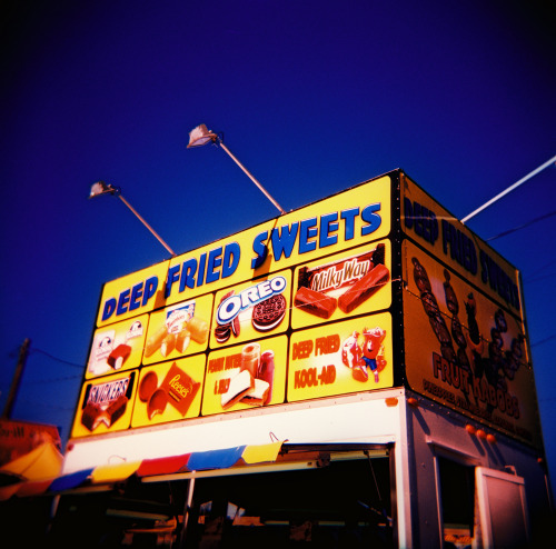 'MERICA- EFF YEAH! DEEP FRIED SWEETS!  Holga, Velvia 100F cross-processed and scanned at 120processing.com.