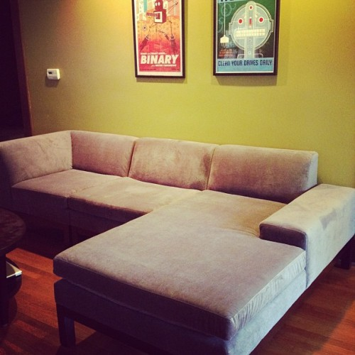 slackmistress:  We finally have a couch that will theoretically seat me, @daisyjdog AND @betheboy ! (Taken with Instagram)  What you're looking at here is a picture of my new couch in my living room.This may seem like a minor thing but it's the first couch I will own that didn't belong to someone else first.  Nearly six years ago I overdrew my checking account in order to meet Nina for a drink. The day before got married we had a combined total of $60 and one job between us. Today, after a million small decisions and a lot of hard work we can spend tonight being the first butts on this couch. We look forward to having your butt on it someday.  *This is normally a bad financial move but since she and I married six months later I stand by it.