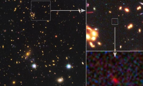 "Discovered: A far-off galaxy from the dawn of time  Astronomers caught a glimpse of what they think is the most distant galaxy ever seen. While it doesn't ""look like much,"" the ""fuzzy red orb"" is an astonishing 13.2 billion light years away, says Rebecca J. Rosen at The Atlantic. That's not much older than the universe itself, and this tiny galaxy may have emerged less than 200 million years after the Big Bang. It's like an archeologist finding an incredibly old artifact that's still relatively intact. More…"