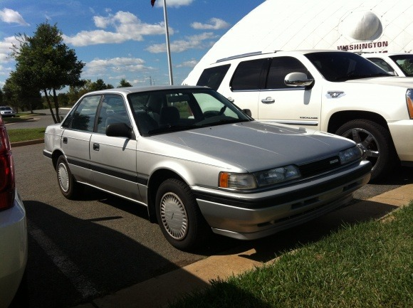 Redskins rookie and starting running back Alfred Morris still drives this silver, 1991 Mazda 626 sedan.