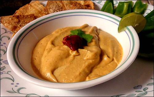 Chipotle Hummus!  Ingredients 1 15-oz can garbanzo beans, drained 1/4 cup water 2 Tbsp. tahini 1/4 cup lime juice 3 Tbsp. olive oil 1/3 cup chopped cilantro 1 canned chipotle pepper in adobo sauce (you can find it in the Hispanic food aisle of your local supermarket) salt and pepper, to taste Instructions In a blender or food processor, combine the garbanzo beans, water, tahini, lime juice, and olive oil. Blend for 2 minutes on low until smooth.  Add the cilantro and chipotle pepper (if you don't want your hummus to be too spicy, just add half the pepper). Blend until smooth. Mix in the salt and pepper, to taste, and serve with your favorite tortilla chips or veggies! Enjoy!