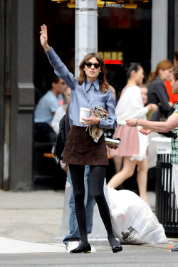 alexastyle:  Alexa Chung sips on a coffee while hailing a cab in the West Village, New York City.