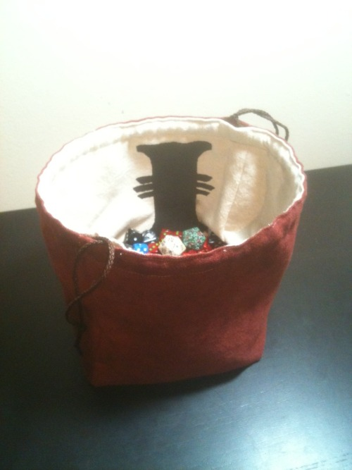 Psst! Hey, buddy!  Your dice look a little sad in that ziploc bag.  Maybe they need a new home?  You should check out Greyed Out Productions on Etsy.  I hear they have really great dice bags, and they're all handmade.  You can get a dice bag that stands open on the tabletop, or a standard design.  They come in really smooth suede, or durable cotton canvas.  They also come with prints on them.   Right now Greyed Out is having a Fall Sale.  Get free shipping with the coupon code FREESHIP, or 25% off your order with FALLBASH.  Pass on the word to everyone you know, because they're gonna be jealous when they see your new dice bag!  Sale goes til the end of October.