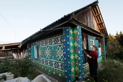 Olga Kostina's house decorated with bottlecaps, in the Siberian taiga