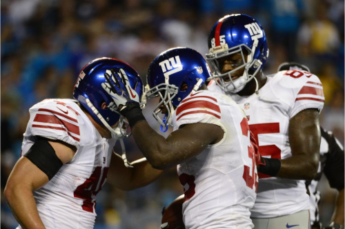 Manning, Brown lead Giants' rout of Panthers