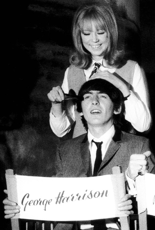 Pattie Boyd doing George Harrison's hair on the set of A Hard Day's Night, 1964.