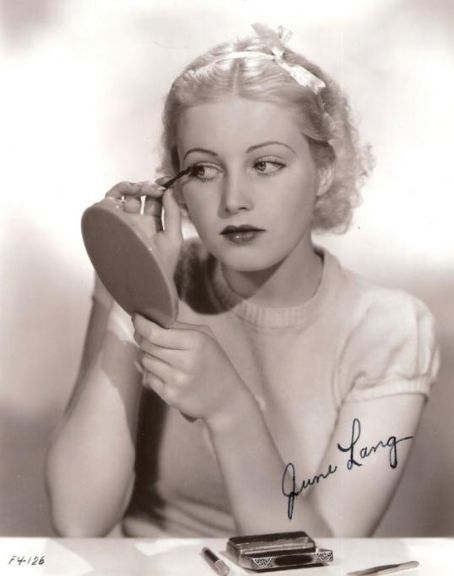 June Lang perfects her makeup - c. 1930's