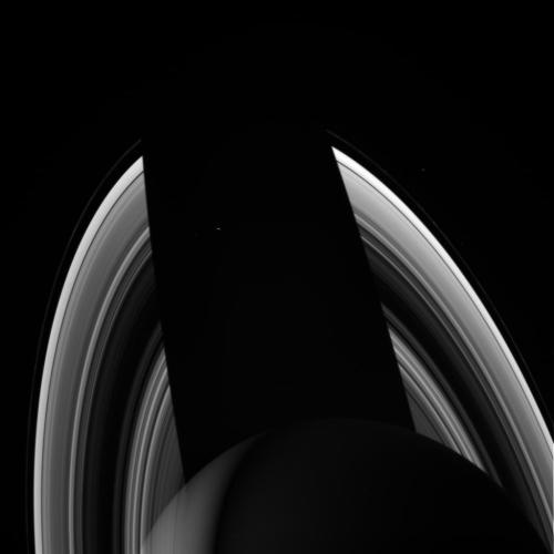 explorationimages:  Cassini: Saturn casts a shadow on its rings, 9/18/2012.  W00075490.jpg was taken on September 18, 2012 and received on Earth September 20, 2012. The camera was pointing toward SATURN-RINGS at approximately 1,381,147 miles (2,222,740 kilometers) away, and the image was taken using the CL1 and CL2 filters.  Image Credit: NASA/JPL/Space Science Institute