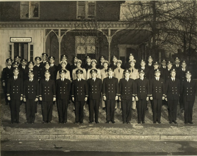 "Black and white photograph of officers in naval dress at the Elco Naval Academy in Rhode Island. John F. Kennedy is in the center row, center. Henry R. Sutphen of Electric Launch Company (Elco) and his designers (Irwin Chase, Bill Fleming, and Glenville Tremaine) visited the United Kingdom to see British motor torpedo boat designs. While visiting the British Power Boat Company, they purchased a 70-foot (21 m) design. During World War I, the company built five hundred and fifty 80-foot submarine chasers for the British Admiralty.  Between the wars, it introduced the 26-foot Cruisette, a cabin cruiser which became successful. This was followed in the 1930s with 30-foot to 57-foot Veedettesand Flattops.  During World War II, Elco formed the Elco Naval Division in Bayonne, New Jersey. Nearly 400 Elco PT boats (""Patrol Torpedo"" torpedo-armed fast attack craft) were produced for the U.S. Navy .   Perhaps the most notable 80-foot PT boat was PT-109, commanded by future president John F. Kennedy. In the film PT 109, the ""Elco"" script logo can be seen on the cockpit throttle housing in several scenes. At the end of the war, the company merged with its sister company, Electric Boat, to form the nucleus of a new corporation General Dynamics. In 1949, General Dynamics decided to focus on government contracts for submarines at Electric Boat in Groton, Connecticut General Dynamics/ Electric Boat Corporation has been the primary builder of submarines for the United States Navy for over 100 years. more"