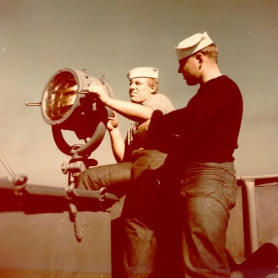 Coast Guard signalman operating a blinker lamp -Photographs of Coast Guard Uniforms 1941-1945