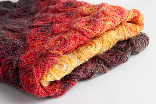 'Fire Blanket' by Tanya Beliak on Ravelry here.  I haven't seen anything like this before!  It's amazing.