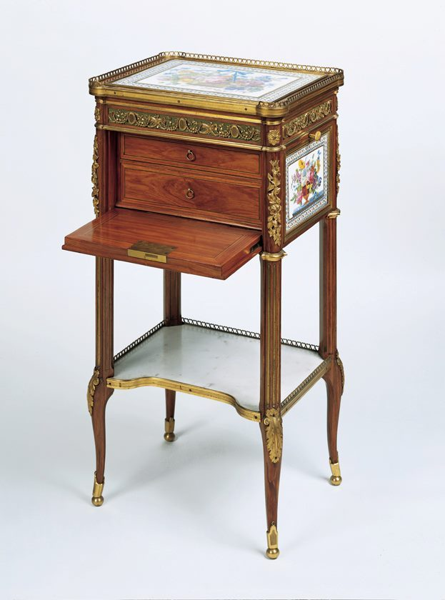 Writing and reading table by Martin Carlin, c. 1784 This little table is a supreme example of the exquisite perfection achieved by these pieces of furniture and would always have been intended as a collector's item.  Martin Carlin produced several of this type, which were ostensibly reading or music stands with an adjustable book-rest, tiny drawers and space for writing implements but which were unlikely to have been in daily use.  They were bought by aristocratic and royal patrons, many of them women, including Marie Antoinette who was so passionate about hers that she consigned it to a dealer for safe-keeping in     October 1789 when the mob was clamouring at the doors of Versailles.