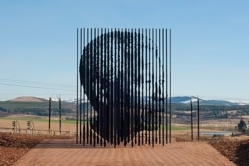 "blu3rsx:  ""nelson mandela monument by marco cianfanelli"" south african artist marco cianfanelli has constructed a monument to recognize the 50 year anniversary of peace activist and politician nelson mandela's capture by the apartheid police in 1962. mandela's profile spans 50 steel columns measuring 21.32 and 29.52 feet (6.5 and 9 meters) high, each anchored to the concrete-covered ground. the shape and form of the sculpture are representative of the leader's 27 years behind bars for his efforts to bring equal rights and governmental representation to the once racially divided nation. the statue of the nobel prize winner has been erected in howick, a town located 56 miles (90 kilometers) south from the city of durban in the countryside of the southernmost african country."