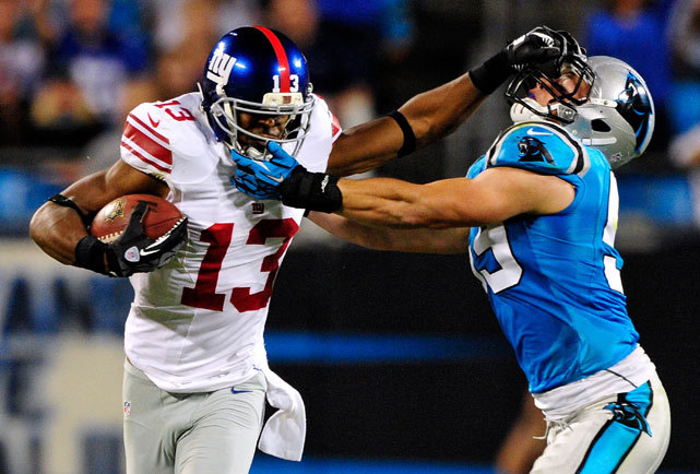 Ramses Barden stiff-arms Luke Kuechly during Thursday's Giants-Panthers game in Charlotte. Barden had a career day, catching nine passes for 138 yards in New York's 36-7 victory. (Grant Halverson/Getty Images)  BURKE: Despite key injuries, Giants dominate Carolina KING: My Week 3 predictions | Fantasy player projections