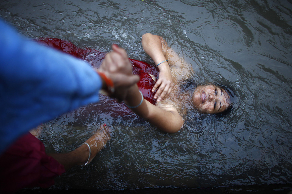 A woman took a dip in the Bagmati River during 'Rishi Panchami,' a purifying and atonement day for women, in Katmandu, Nepal, Thursday. Niranjan Shrestha/Associated Press