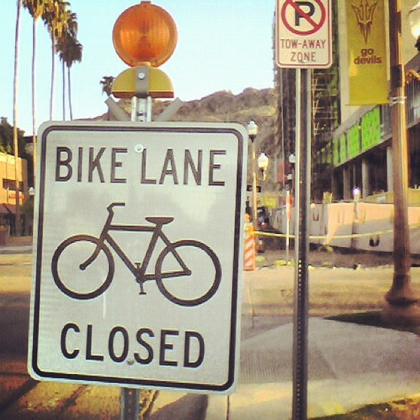 The worst sign in the world #bike lane closed… #firstworldproblems on the other hand, #GoDevils! #ASU #Tempe #bikeride  (Taken with Instagram at College Dropouts)