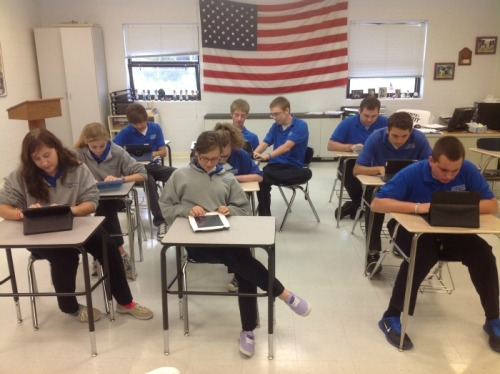Students in Clarksville, Indiana, writing to penpals in New York City.