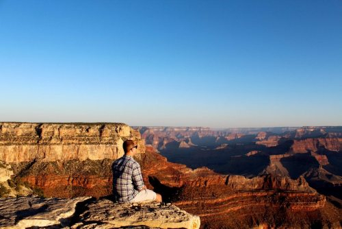 Watching the sunrise at the Grand Canyon.