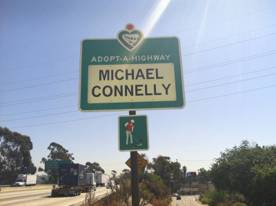 (via Michael Connelly Books) Take a look at what Michael's publisher, Little, Brown and Company, did as a gift for his 20th year in publishing. They adopted a section of a Los Angeles highway in his honor and will keep it clean and beautiful. This is the Southbound side of I5 near Dodger Stadium. How cool is that!