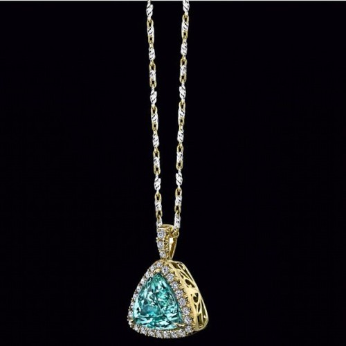 Introducing A Neon Paraiba Tourmaline Pendant!  This flashy 4.39 carat Neon Paraiba #Tourmaline glows a beautiful #turquoise color and is certified by the #Gemological Institute of America (GIA).  This lively #gemstone is mounted in an #18k Artisan Style #pendant and highlighted by 27 Round Brilliant #diamonds weighing a total of 0.41 carats. #necklace #gold #jewelry #design #style #fashion #blue #bling #love #pretty #instagood (Taken with Instagram)