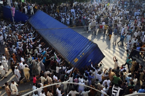 Pakistan 'Day of Love' protests erupt in violence, leaving over a dozen dead (Photo: Arif Ali / AFP - Getty Images) NBC News staff and wire reports — ISLAMABAD, Pakistan — Protests by tens of thousands of Pakistanis infuriated by an anti-Islam film descended into deadly violence on Friday, with police firing tear gas and live ammunition in an attempt to subdue rioters who hurled rocks and set fire to buildings in some cities. Read the complete story.