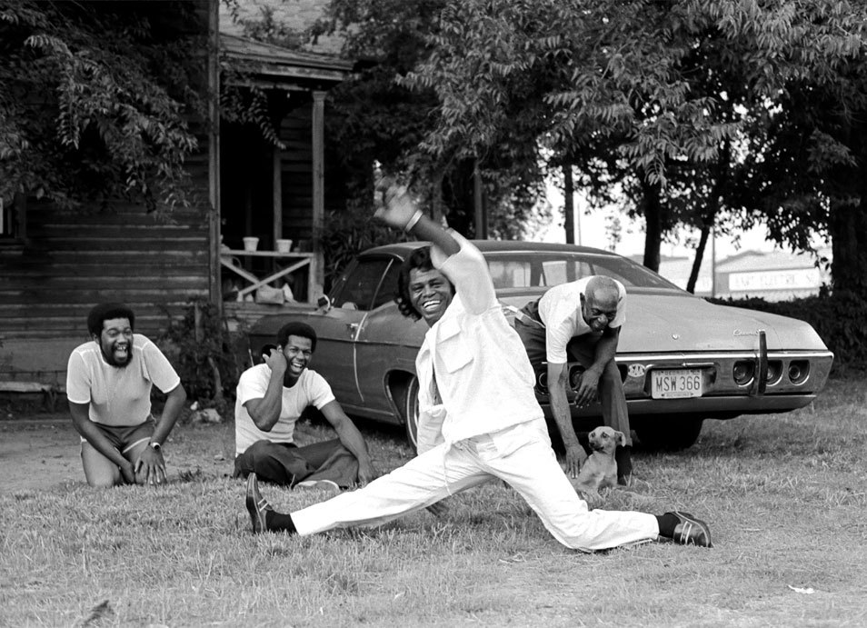 """In Augusta, to photograph James Brown, these pictures were taken when he suggested we go for a ride. He told me he would show me 'his town.' So we jumped into an old car and drove around. He would stop the car when he saw someone sitting in their yard, run up, do the split, yell out, 'I feel good,' and jump back in the car and drive off. It was all so spontaneous and hilarious, and it took the onlookers by such surprise. Brown was a fun-loving character and a good sport."" Harry Benson, Photographer Via youmightfindyourself:"